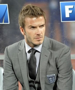 David Beckham with a pronounced jaw wearing wide-spread shirt collar with full windsor knot tie