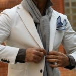 The Ascot Knot using a grey scarf on a white suit